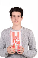 Man eating popcorn.
