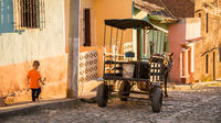 Horse carriage on streetside in Trinidad, Cuba at sunset