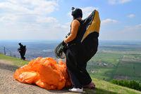 paraglider prepares to jump