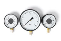 The pressure sensor in the pipeline is a manometer. Three gauges of different sizes on a white isolated background