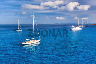 Early morning in in Formentera. Sailboats at Cala Saona bay. Spain