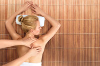 Young woman having body and back massage in spa