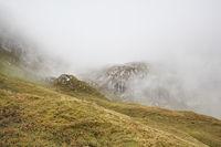 rocky mountains in dense fog