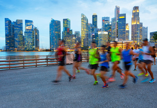 Running group of people. Singapore