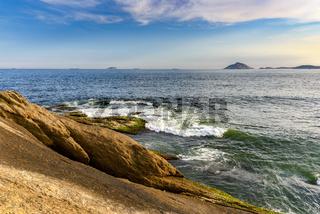 Rock and sea in Arpoador beach and Cagarras islands