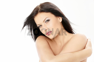 Beautiful woman clasps the bared shoulders
