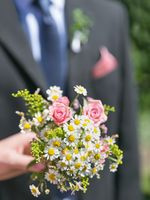Bridal bouquet. Beautiful nosegay in hand of bride
