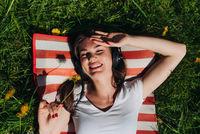 Woman listening music outdoors