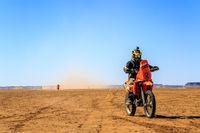 Ait Saoun, Morocco - February 22, 2016: Unidentified man in helmet riding bike in Ait Saoun desert of Morocco.
