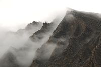 Mountain cliffs in fog