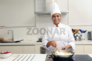 Chef cooking a tasty  risotto  in a modern kitchen
