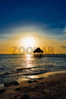 gazebo bridge Caribbean sea at sunset