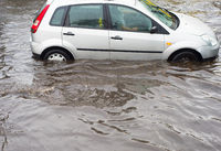 Car road flooded by water
