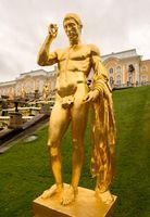Golden statue by cascade at Peterhof Palace