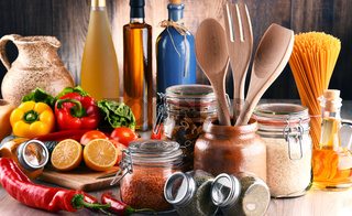 Composition with assorted food products and kitchen utensils