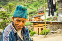 Man with knitted cap in Nepal
