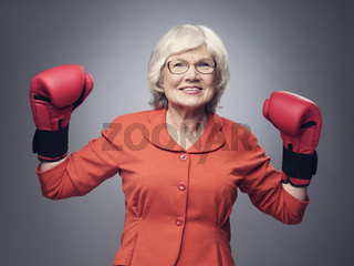 Senior lady in boxing gloves