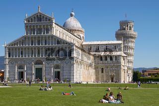 PISA, ITALY - SEPTEMBER 29, 2010: Tourists Enjoying Sunny Day in Front Of the Leaning Tower of Pisa in Tuscany, Italy