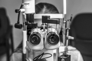 Beautiful young woman having eye test at the optometrist