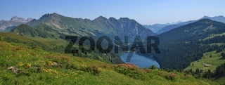 Blue lake Arnensee and green meadows