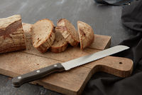 Fresh bread on wooden board