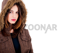 fashionable young lady wearing overcoat on an isolated background