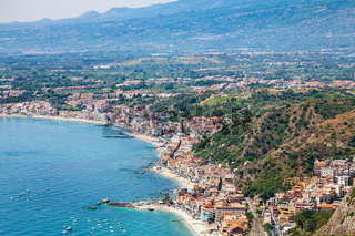 view of Giardini Naxos town on Ionian Sea beach