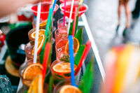 Colorful cocktails close up. an open-air party. after the rain