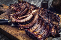 Barbecue Pork Spare Ribs as top view on an old cutting board