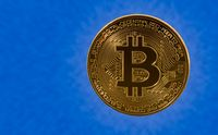 Single bitcoin with blue cloud background