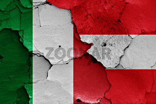 flags of Italy and Austria painted on cracked wall