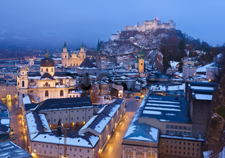 City and castle Hohensalzburg at sunset