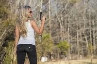 Gorgeous Blonde Model Protecting Herself With A Pistol