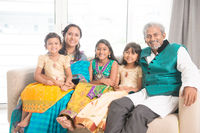 Indian family of five smile at camera