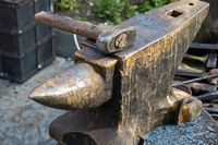 Old hammer and rusty anvil