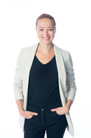 Business woman standing against white background.