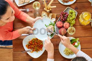 women eating chicken for dinner