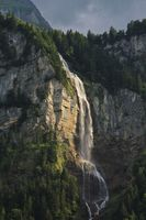 Majestic waterfall Oltschibachfall. Waterfall near Meiringen. Swiss Alps.
