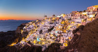 Oia village at sunset, Santorini island, Greece.