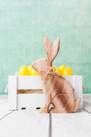 Traditional Easter holiday basket with a bunny and eggs