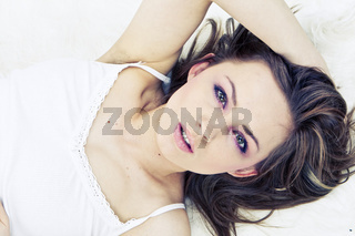 Young woman laying bed