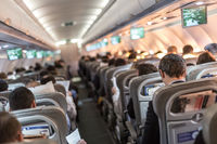 Interior of airplane with passengers on seats waiting to taik off.