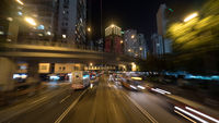 Night Hong Kong cityscape with transport traffic on the road