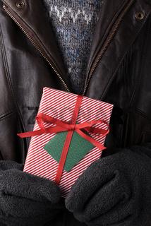 Closeup Man Holding Christmas Present