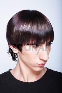 Cute young guy with fashion haircut