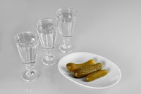 Three glasses of vodka with snack