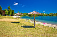 Beach and parasols on Soderica lake