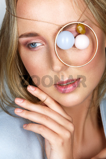 beautiful girl with natural makeup and jewerly on eye