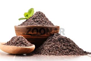 Bowl of poppy seeds on white background.