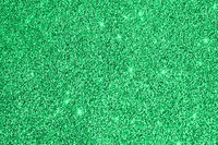 Green glitter sparkle background. Christmas shiny easter abstract texture. Greeting card template. Copy space